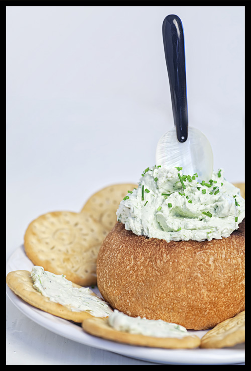 Three Cheese and Herbs Dip served with bread and crackers