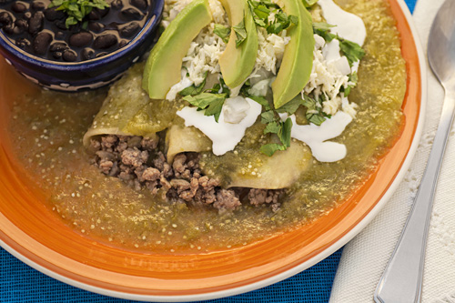 Green Enchiladas with Ground Beef served with beans