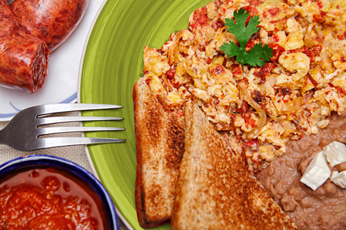 Scrambled Eggs with Chorizo served with beans and bread