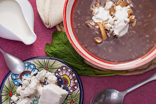 Black Bean Soup with cream, cheese and fried tortilla strips
